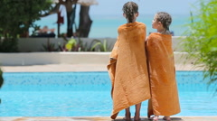 Little girls wrapped in towel after swimming Stock Footage