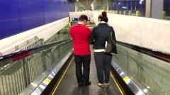 People taking escalator inside Ikea store Stock Footage