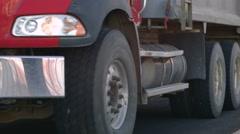 Road construction - asphalt dump truck reversing - stock footage