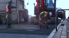 Road construction - circular concrete asphalt saw Stock Footage