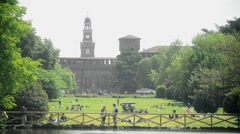 Milan, Italy - park Sempione - people have rest, play ball, relaxing on the sun - stock footage