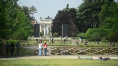 Milan, Italy - park Sempione - people have rest, walking, relaxing on the sun Stock Footage