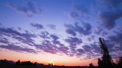 The movement of clouds at sunset, bright rich colors, fast-moving clouds Stock Footage