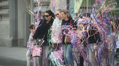Milan, Italy,day street life - performance with brightly colored ribbons Stock Footage