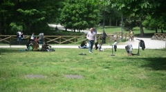 Milan, Italy - park Sempione - people have rest, walking, relaxing on the sun - stock footage