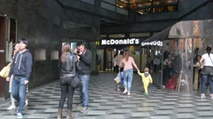 Milan, Italy,day street life - people go to McDonald's Stock Footage