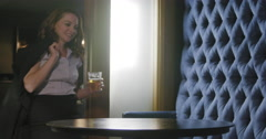 Young business woman drinking beer in a lounge bar 4K - stock footage