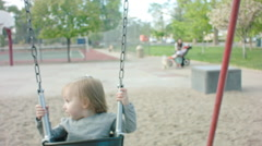 Little Girl toddler Swinging at a Park Stock Footage