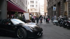 Croud of people in center of Milan walking, expensive car  - spring day Stock Footage