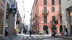Croud of people in center of Milan walking looking in showcase shop - spring day - stock footage