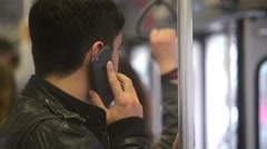 Man talks to Mobile sell phone in Tram Stock Footage