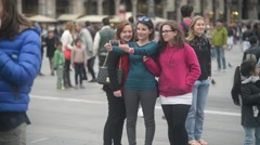 Girls making selfie by Mobile phone in center of Milan piazza Duomo Stock Footage