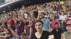 Football stadium in Spain. Fans support players on tribunes. Raise hands - stock footage
