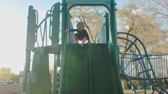 Little Girl Sliding down a Slide Stock Footage