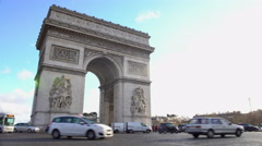 Many cars driving by Arc de Triomphe in sunlit Place Charles de Gaulle in Paris - stock footage