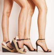 Two pair of woman legs in hight heels shoes Stock Photos