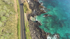 AERIAL: Beautiful picturesque countryside road above the rocky ocean cliffs Stock Footage