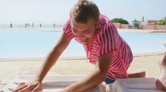 Man in pink tunics sexy posing look in camera at swimming pool. Depict woman Stock Footage