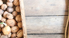 Fresh walnuts in a wooden box Stock Footage