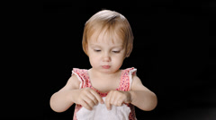 Keyed Little Cute Girl wiping her Face and Hands with a Tissue Stock Footage