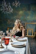 young blond woman wearing crown in fairy luxury interior with empty antique - stock photo