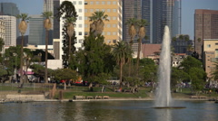 Los Angeles MacArthur Park Day 04 Palm Trees by Pond Stock Footage