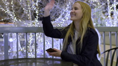 Teen Girl Waits At A Table, Her Friends Arrive, She Waves, And Exits Frame Stock Footage