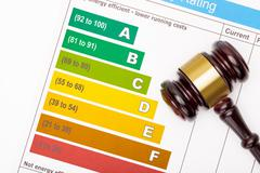 Wooden judge gavel over colorful efficiency chart Stock Photos
