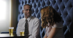 Business people talk and drink beer in lounge bar 4K Stock Footage
