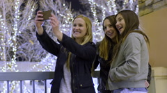 Girl Checks Phone, Her Friends Show Up, They Take Cute Selfies Together Stock Footage
