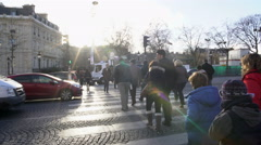 Many busy people crossing street in old European city, observing traffic rules Stock Footage