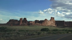 "ARCHES NATIONAL PARK, evening drive near the ""Courthouse"" monuments. Stock Footage"