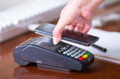 Credit card machine with a code reader in a smart mobile phone, easiest way to - stock photo