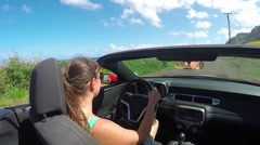 CLOSE UP: Young woman on vacation driving convertible exploring sunny island Stock Footage