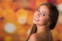 Beautiful girl showing her naked shoulder, smiling expression - stock photo
