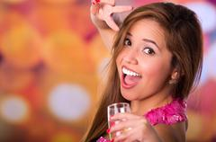 Happy woman making peace and love expression hand and holding champagne cup with Stock Photos