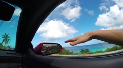 SLOW MOTION CLOSE UP: Driving in cabriolette, hand playing with wind in summer Stock Footage