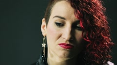 Portrait of red curly hair woman with bright make up, red lips. Pronounce Stock Footage