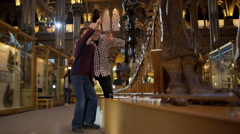 4K Father & son in natural history museum looking at the exhibits with amazement Stock Footage
