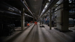 4K Team of engineers in power station, wide shot of workers & interior structure - stock footage