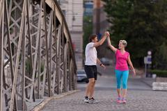 couple congratulate and happy to finish - stock photo