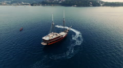 The camera rotates around a sailing ship in the sea. Aerial made with drone N. Arkistovideo