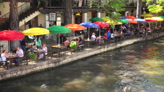 Tourists at Restaurant Along the San Antonio River Walk in Texas Stock Footage