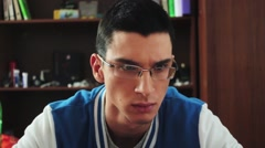 Portrait of young boy in glasses try concentrate look in screen. Make massage of - stock footage