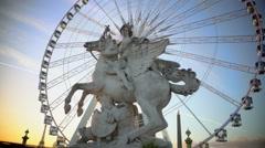 Mercury riding Pegasus statue and giant Ferris wheel in Tuileries Garden, Paris - stock footage