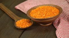 Red Lentils In A Ceramic Bowl On Old Wooden Table Stock Footage