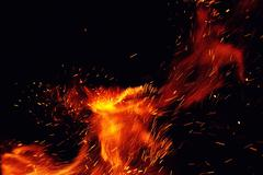 Fire flames with sparks on a black background Stock Photos