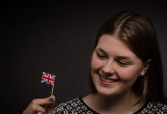 Woman with the flag of Great Britain Stock Photos