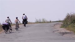 Group of cyclists go on a trip that hardly climb on a paved road ramp Stock Footage
