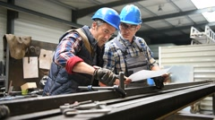 Manager controlling employee's metallurgy work - stock footage